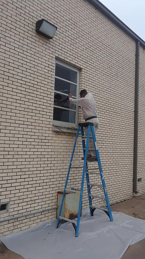 Lead Abatement project by Quality Air Controllers Outside Windows